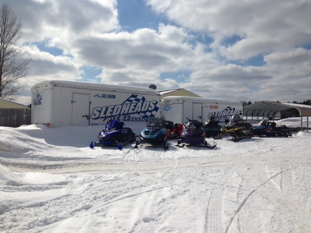 sleds parked by the sledheads trailer