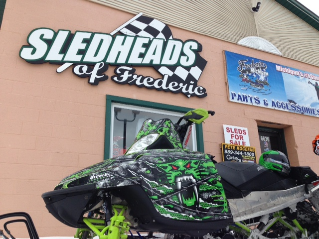 Cool Wrapped Arctic cat in front of Sledheads of Frederic