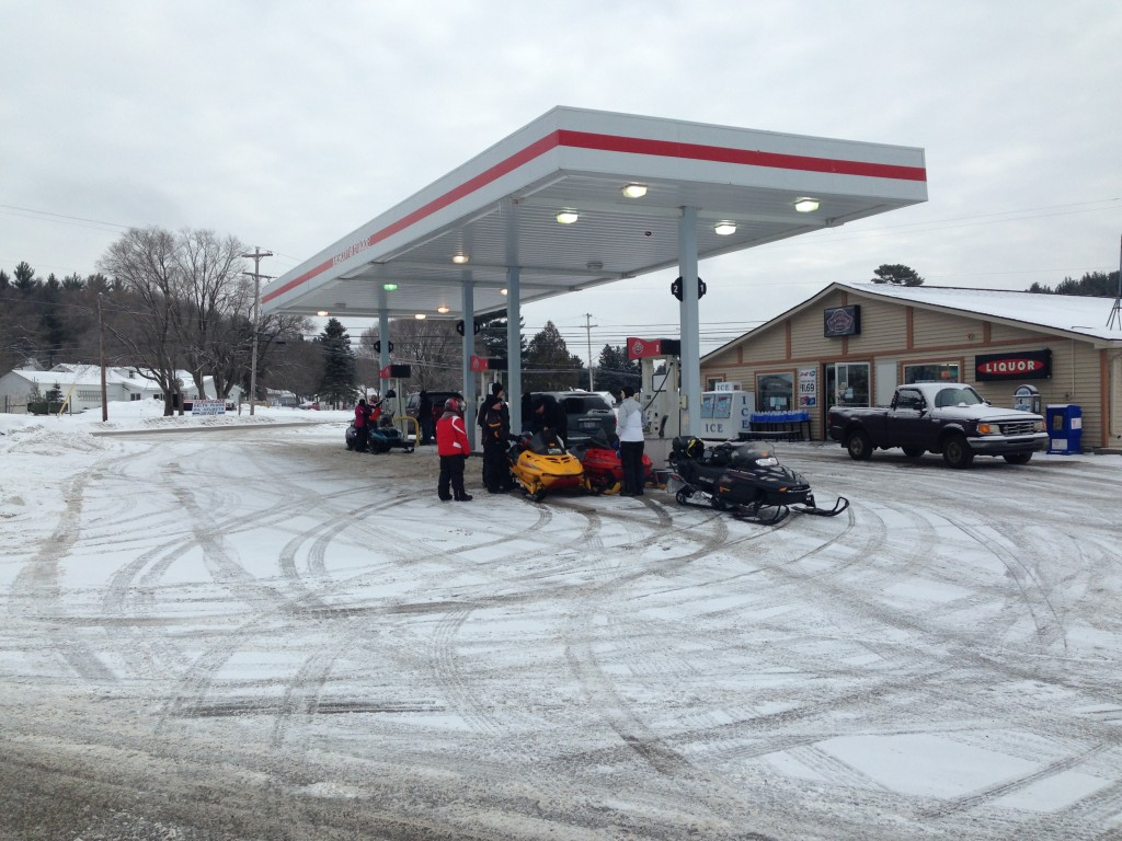 Saturday 3/5/16 9:00 a.m. Sleds fueling up in Frederic, Mi