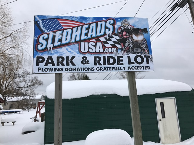 my new park & ride sign behind Sledheads