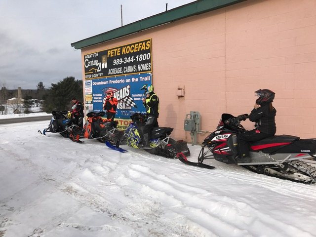 Riders stopping at Sledheads of Frederic