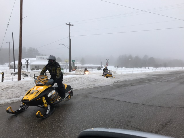 sleds wed morn in Frederic @ gas station