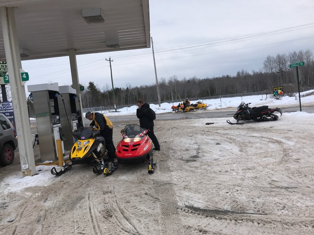 sleds gassing up in Lovells